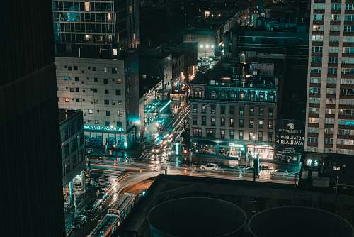 city aerial photography of lights in city buildings during nighttime intersection