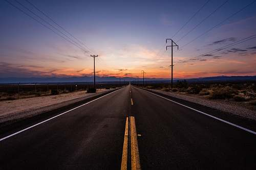 freeway empty road during golden hour death valley national park