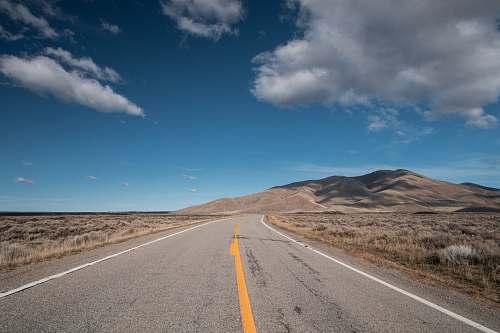 sky selective focus photo of road under blue sky idaho