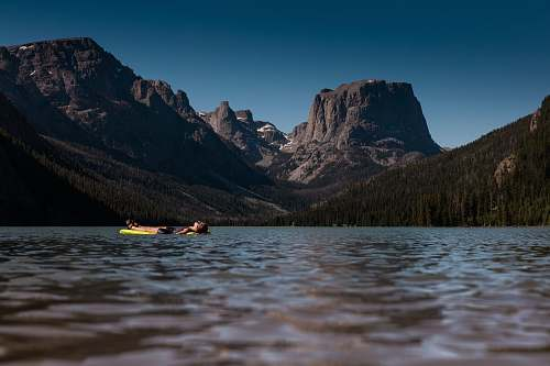 vessel boat with view of rocky mountains watercraft