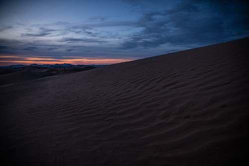 desert desert sand under orange sky dune