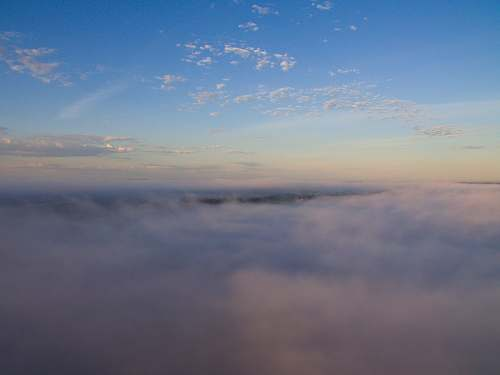 dawn aerial view photography of cloudy sky dusk