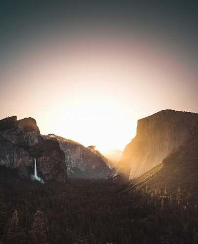 nature brown mountains during daytime sunrise