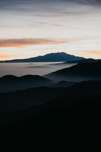sunrise mountain filled with mist sunset