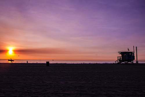 venice beach silhouette photography of house near sea at sunset los angeles