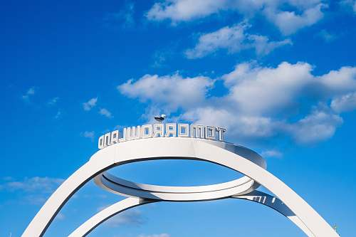 building white and blue round frame under blue sky during daytime architecture