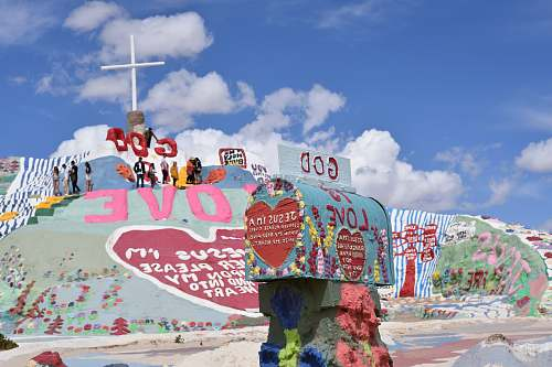 salvation mountain multicolored God is Love paintings under clear blue sky art