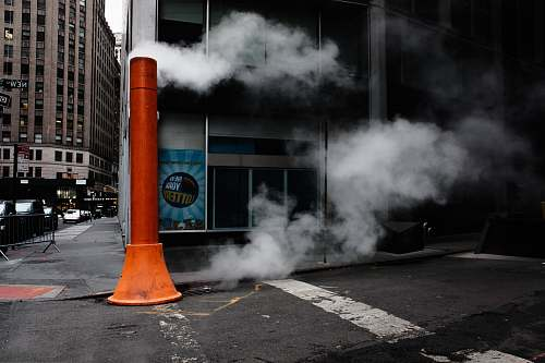 new york orange post near building asphalt