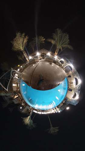 light brown swimming pool and coconut palm trees little planet flare