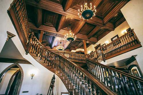 banister white and brown wooden house with stairs handrail