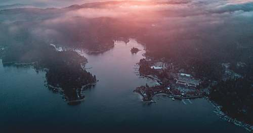 sunset aerial photography of land and sea aerial view