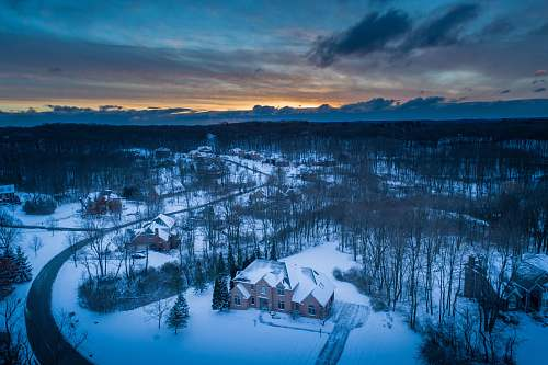 sunrise aerial photography of houses covered with snows building