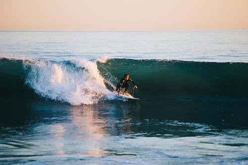 ocean man surfing on ocean wave during daytime sea