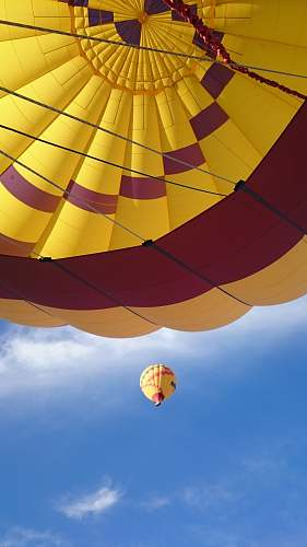 photo hot air balloon low angle photograph of yellow and red hot air balloon aircraft free for commercial use images