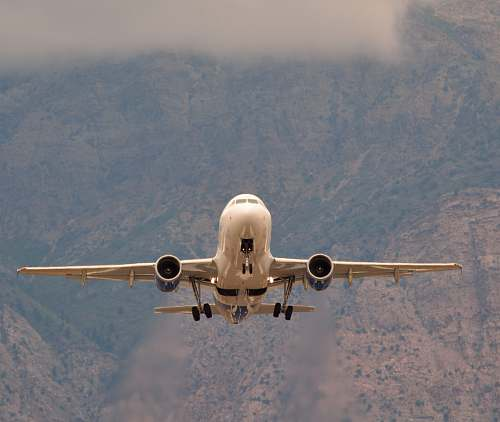 vehicle white airliner on flight during daytime aircraft