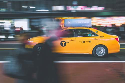 cab yellow sedan on gray road taxi