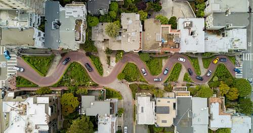 lombard street aerial photography of gray concrete houses and brown road aerial view