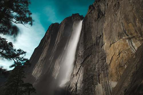 mountain low angle photo of waterfalls outdoors