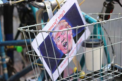 los angeles Donald Trump paper inside bicycle basket politics