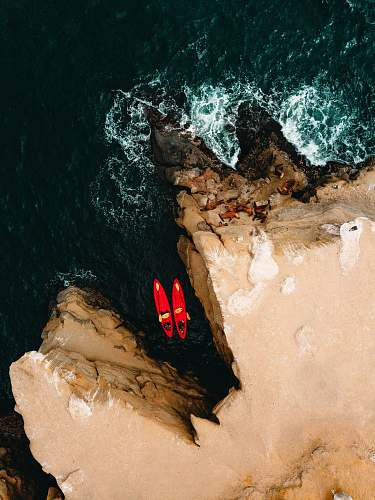 la jolla aerial photography of two red kayaks san diego