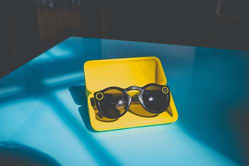 neonbrand digital marketing black sunglasses in yellow case on table las vegas