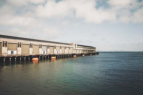 san francisco gray building near body of water pier 39