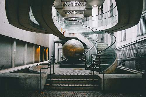 san francisco landscape photography of grey staircase with globe under embarcadero center