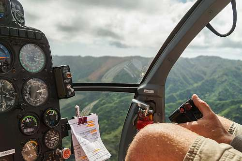 hawaii person driving helicopter from above cockpit