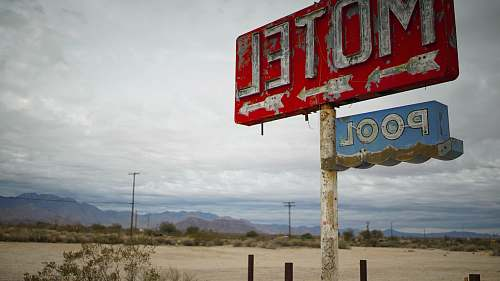 amargosa valley red motel signage in shallow focus clouds