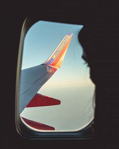 san francisco silhouette of person looking at airliner wing emblem