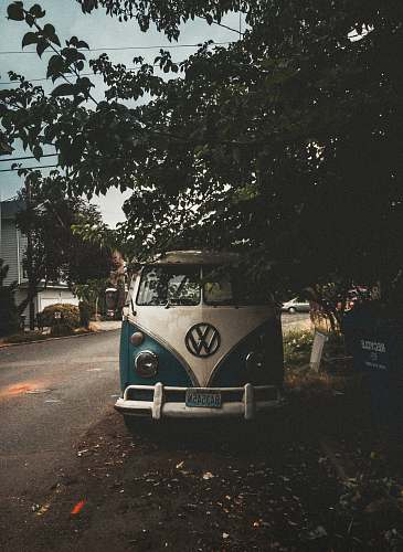 photo seattle white and blue Volkswagen van park beside road capitol hill free for commercial use images
