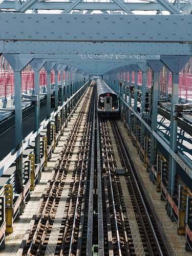 transportation gray train during daytime train