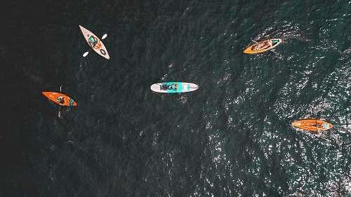 nature aerial people riding kayats ocean
