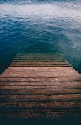 ocean brown wooden stair on calm body of water belmar