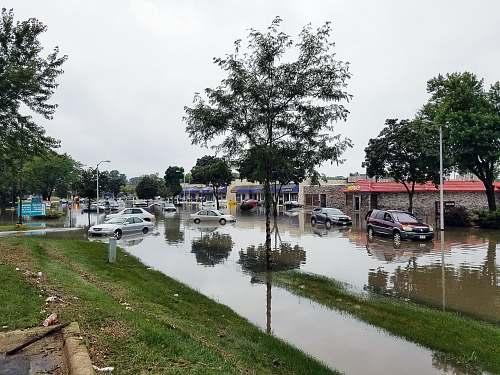 flooding cars on flooded street flood