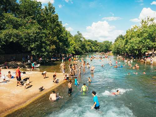 outdoors group of people in body of water during daytime austin