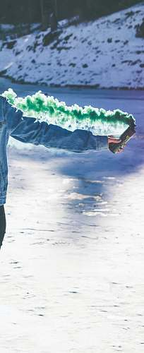 tibble fork reservoir person holding green smoke can united states