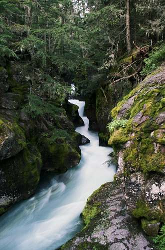 outdoors time-lapse photography of stream between rocks stream