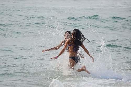 ocean two women walking on body of water play