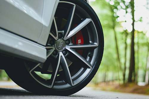 machine white Audi vehicle with gray wheels tire