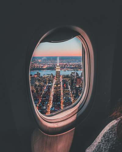 porthole plane window photo of Empire State Building travel