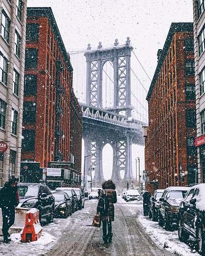 snow woman facing towards Brooklyn Bridge in New York city