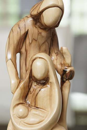 ivory man and woman with baby wooden sculpture figurine