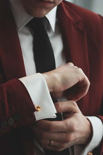 accessory man wearing maroon and white dress suit tie