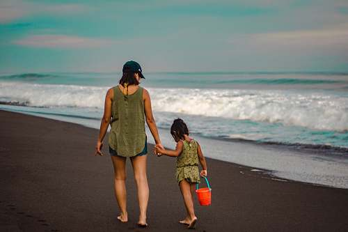 clothing mother and daughter walking near hore shorts