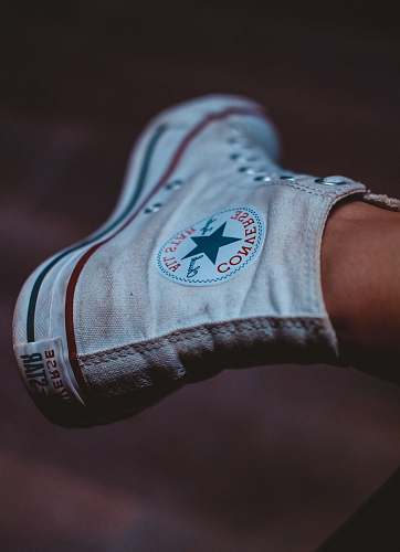 clothing selective focus photography of person wearing white Converse All-Star high-top sneaker footwear