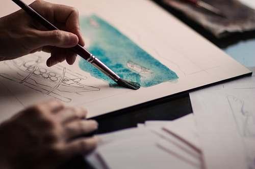 creative person holding paint brush artist