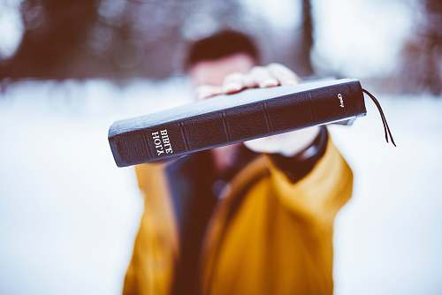 photo church person holding Holy Bible christian free for commercial use images