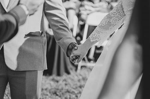 grey wedding couple hold each other's hand hand