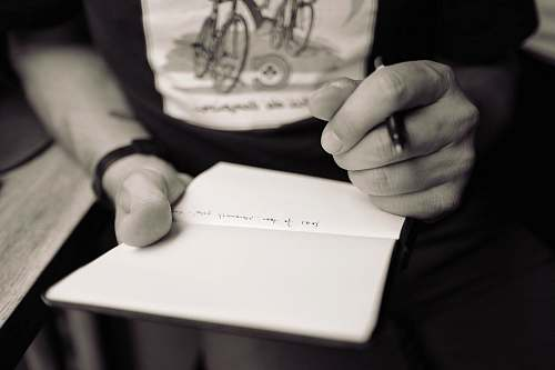 writing person writing on notepad hands